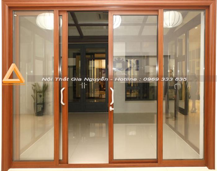 Mẫu cửa đi nhôm Xingfa mở trượt màu vân gỗ
